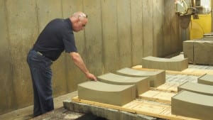 City Engineer Hassan Zahran inspects sandstone cut in a similar way our radii would be treated.